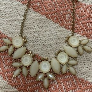 Cream stone and gold necklace